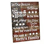 "Wood wall hanging with military family messages. Faint American Flag wood plank background. Decal messages in white.28""H X 20""W."