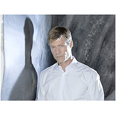 V with Joel Gretsch as Father Jack Landry in White Looking