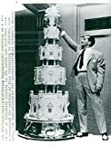 Vintage photo of The condom Mikes Rageuzaridis gives the wedding cake a final review