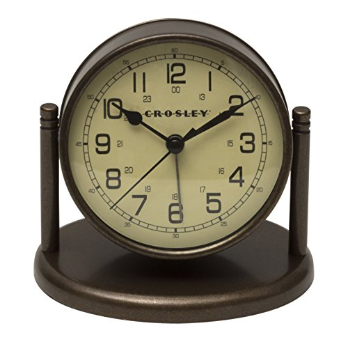 - Crosley 33860 Nautical Alarm Clock for Desk Side Table and Night Stand, All Metal Case with Dome Glass Lens, Adjustable Viewing Angle, Simple Operating Controls, Bronze