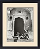 Framed Print of India - An Indian Woman Spinning in an ornate entrance
