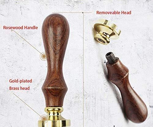 Mango de madera estilo vintage y sello con dise/ño de br/újula