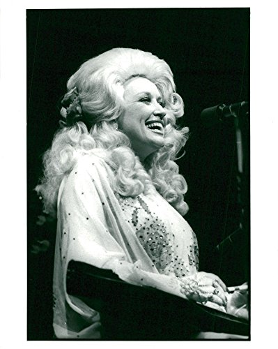 Vintage photo of Country star Dolly Parton in front of the microphone plays a zither or autoharp