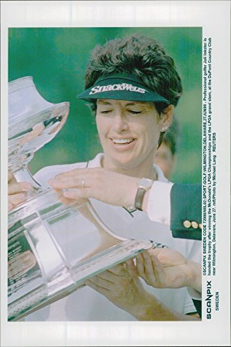 Vintage photo of Golf Incident Julie Inkster receives the trophy after winning McDonald's LPGA Championship and LPGA Grand Slam at DuPont Country Club - Julie Inkster Memorabilia