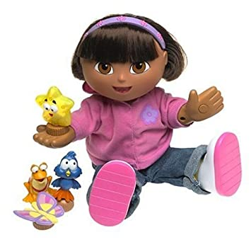 819a7a5ab Fisher-Price Magical Friends! Singing Dora the Explorer: Amazon.co.uk: Toys  & Games