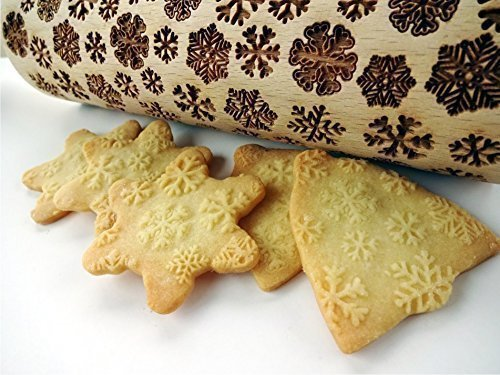 Rolling pin with snowflake pattern. Embossing rolling pin for Christmas gingerbread with SNOWFLAKES.