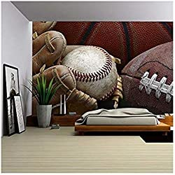 wall26 - Close Up Shot of Well Worn Baseball in Baseball Glove, Football and Basketball - Removable Wall Mural | Self-adhesive Large Wallpaper - 66x96 inches