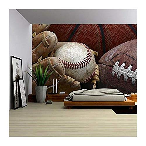 wall26 - Close Up Shot of Well Worn Baseball in Baseball Glove, Football and Basketball - Removable Wall Mural | Self-adhesive Large Wallpaper - 66x96 inches