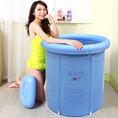 Woman kneeling on the floor and posing with hands on the portable bathtub.