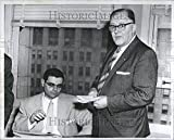 """Photo measures 10 x 8 in. Oscar J.Reiss, pre of """"Famous Windows"""" with James Stewart, chief investigator for Prosecutors office with warrant for his arrest at hearing."""