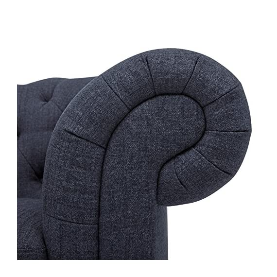 """Stone & Beam Bradbury Chesterfield Oversized Tufted Accent Arm Chair, 50""""W, Navy - An updated twist on the classic Chesterfield design, this handsome tufted arm chair is as comfortable as it is eye-catching. Its sturdy design and high performance upholstery will hold up to your busy family. 50""""W x 39""""D  x 30.3""""H Solid and engineered hardwoods; polyester/nylon fabric - living-room-furniture, living-room, accent-chairs - 51AgS%2BU786L. SS570  -"""