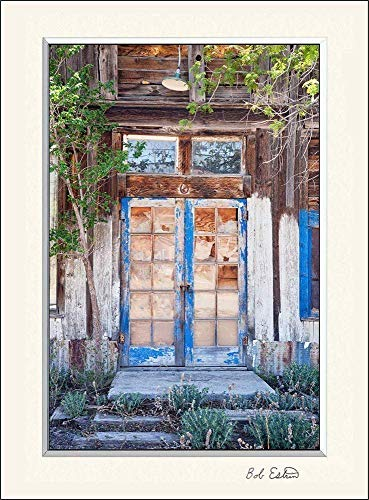 11 x 14 inch mat including a wall art photograph of a well worn wooden blue door with reflecting window panes. This distressed abandoned garden NM ghost town