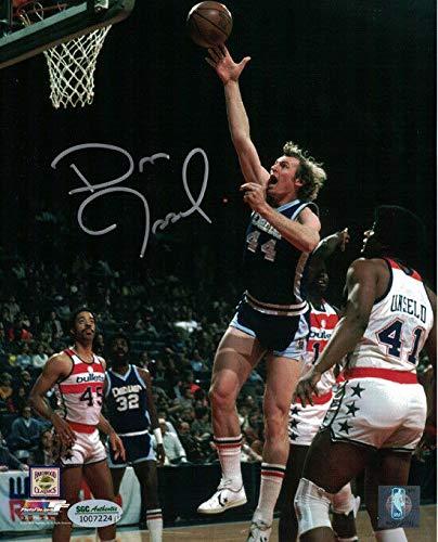 (Dan Issel Autographed Denver Nuggets 8x10 Photo vs Bullets SGC)