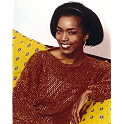 Posterazzi Poster Print Collection Angela Bassett Seated in Red Photo Print (8 x 10), Multicolored
