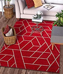 Plaza Geometric Red is a bold, bright pattern of tiled shapes, woven in vibrant colors of ruby red, charcoal, light grey, and ivory. The densely woven pile of super soft yarn has a smooth, textured feel and exceptional, naptime level plushnes...