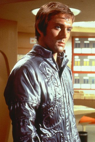 Michael Billington in silver space suit as Foster UFO cult s