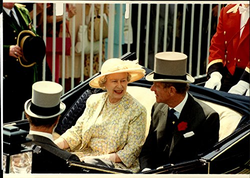Vintage photo of Queen Elizabeth and Prince Philip in the traditional short race to open the race race The Royal Ascot