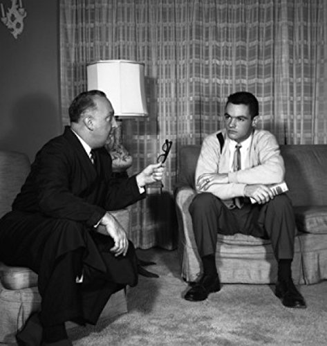 Two men talking in living room Poster Print