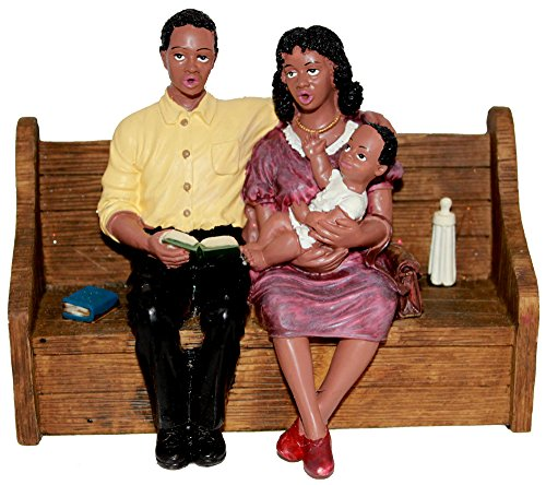 African American Church Couple with Baby in Pew