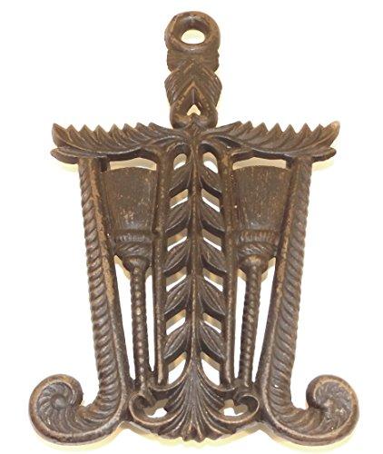 (Vintage Cast Iron Sad Iron Trivet with Brooms Design)