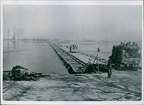 Vintage photo of Troops and the equipment of the third U.S. Army roll across the Rhine on a pontoon bridge erected in half a day by Combat engineers. 1945