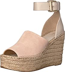 Elevate your vintage-inspired style in the stunning Marc Fisher LTD™ Adalyn espadrille wedge. Available in a variety of upper materials. Please note: upper material is listed in the color name. Ankle strap with adjustable buckle closure. Open...