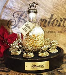 Our Blanton's stopper display is the perfect collectors item to display the 8 RARE Limited Edition GOLD Blanton's horse stoppers with are included with this. The display exquisitely presents the Gold horse stoppers racing in a horseshoe shape...