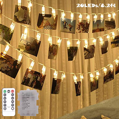 20 LED Photo Clip Fairy String Lights,Indoor Outdoor Battery Box Powered,Remote,8 Modes,Timer,Gift for Valentine's Day Hanging Pictures,Cards,Artwork,Memos, Dorms,Bedroom, Wall Decoration (Warm White)]()