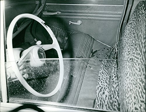 Vintage photo of Blood stains on the cover of the car seat.Taken - Circa 1962