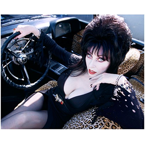 Cassandra Peterson is Elvira Seated in Her Car Holding Wheel 8 x 10 Inch Photo