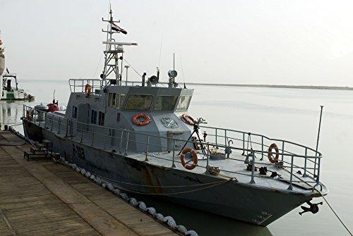 Laminated Poster an Iraqi Navy Coastal Patrol Boat is moored to a pier at UMM Qasr, South Port Terminal in Basra, Ir Vivid Imagery Poster Print 24 x 36