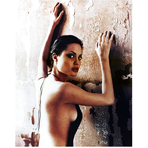 Angelina Jolie Wearing Backless Dress Head Turned Leaning Hands on Wall Closeup 8 X 10 Inch Photo