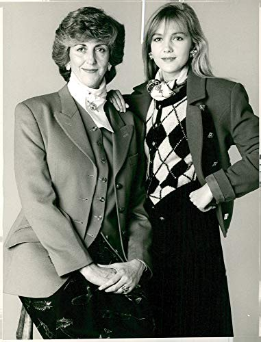 (Vintage photo of Fashion sea lady brittan who wearing in a gold wool tailored jacket and ms katherine peterson is wearing in red wool jacket.)