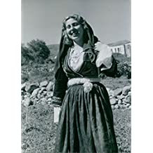 Vintage photo of Woman wearing traditional dress.Greece