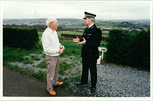 (Vintage photo of Chief constable ray white of carmarthen with some of the villagers.)