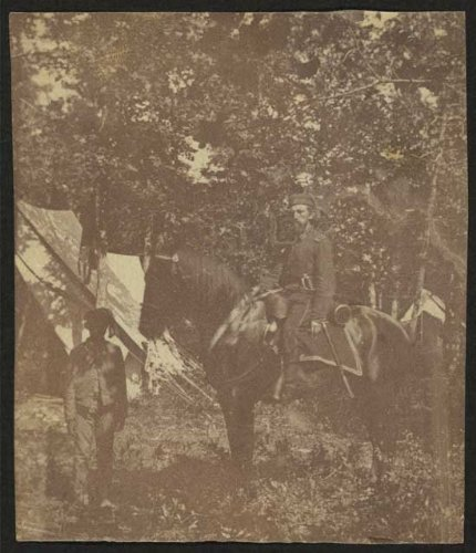 Photo: Soldier, horseback riding, African American servant, military, tents, Civil War, 1861 . Size:
