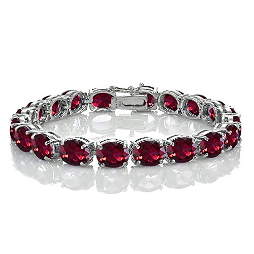 Sterling Silver Created Ruby 9x7mm Oval Tennis Bracelet
