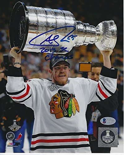 Autographed Marian Hossa 2013 Stanley Cup overhead 8x10 unframed photo.