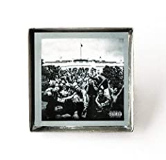 """This is a pin featuring album art of the """"To Pimp a Butterfly"""" record by Kendrick Lamar in a silvertone metal setting with glass. The album cover pin measures 1"""" and is individually handcrafted by me in the USA. Show off your favorite artist!..."""