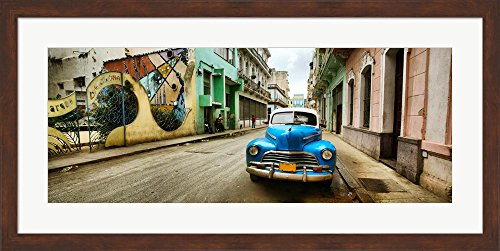 Old car and a mural on a street, Havana, Cuba by Panoramic Images Framed Art Print Wall Picture, Brown Frame with Hanging Cleat, 38 x 19 - Pictures Havana Brown