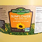 Healthy Harvest Non-GMO Sunflower Oil 7 NATURAL SUNFLOWER OIL - Bring the best of nature to your table, with our Non-GMO healthy cooking oil, created without chemicals, hydrogenation or other damaging processing. The approximate smoke point of our Sunflower oil is 450 degrees. FARM FRESH - Traceable to farm of origin, our Non-GMO Sunflower Oil is naturally processed, using physical refining methods that ensure inherent, natural antioxidants, Omega-3 fatty acids and Vitamin E are retained. NO TRANS-FATS - Enjoy flavorful meals without harmful impacts to your heart, blood sugar and overall health with this healthy cooking oil - in fact, Sunflower Oil can even help reduce your cholesterol.