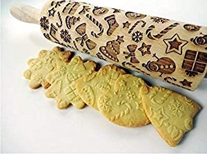 Rolling pin CHRISTMAS GIFTS. Christmas gingerbread cookies. Embossing rolling pin with Christmas symbols.