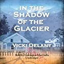 In the Shadow of the Glacier Audiobook by Vicki Delany Narrated by Carrington Macduffie