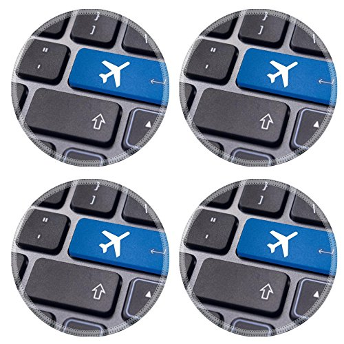 MSD Round Coasters IMAGE ID 20325071 a plane sign on keyboard to illustrate online booking or purchase of plane ticket or business travel concepts (Air Tickets Purchase compare prices)