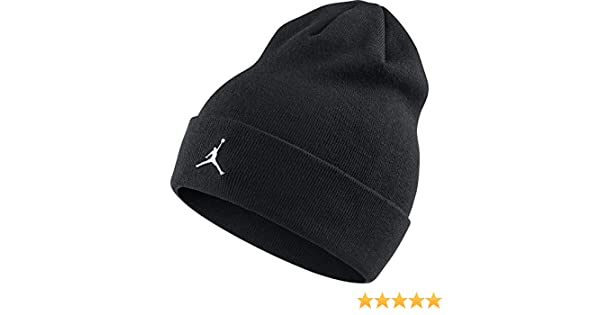 b60bace4df1a Amazon.com  Nike Mens Jordan Cuffed Metal Logo Beanie Black AA1297-010   Clothing