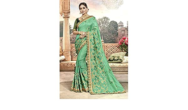 399c49d7861 Amazon.com  Triveni Embroidered Chanderi Silk Green Saree for Women with  Unstitched Blouse