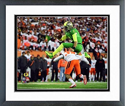 Marcus Mariota Oregon Ducks NCAA Football Action Photo (Size: 12.5'' x 15.5'') Framed by NCAA