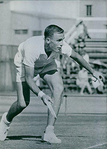 Vintage photo of John Newcombe playing tennis.