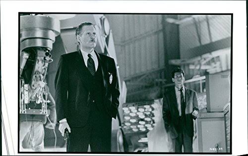 """Over the hill photo of Stephen Spinella and William Forsythe in a scene of the movie, """"Virtuosity""""."""