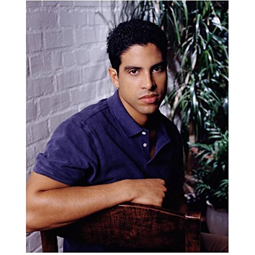 CSI: Miami 8inch x 10inch Photo Adam Rodriguez Blue Polo Shirt Right Arm Over Back of Wooden Chair kn ()